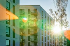 Facade apartment house copy space green tree sun light. Facade of a modern residential apartment house building. Including place for copy space. And green tree royalty free stock photos
