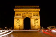 Facade of Arc de Triomphe at night Royalty Free Stock Image
