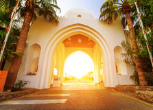 Facade of arch at the entrance beautiful hotel in Egypt. Facade of arch at the entrance beautiful hotel at a tropical holiday resort in Egypt Royalty Free Stock Image