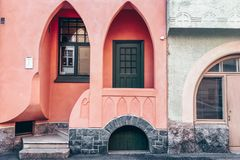 Pink arch facade of a classic Jugendstil building, Helsinki - Finland. The facade of a Jugendstil building. Unique pink house with an arched doorway entrance and royalty free stock image
