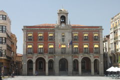Facade with arches Zamora. Facade of the City hall of Zamora in Spain, with some balconies and arches as a gateway. There are some flags royalty free stock photos