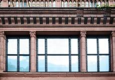 Facade architectural building with Windows and columns Stock Photos