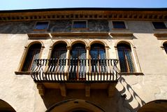 Facade with balconies and old windows in Padua in the Veneto (Italy). Photo made at the historic building in Via del Santo that the Basilica of St. Anthony in royalty free stock photo