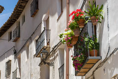 Facade. Balcony decorated with flowers in a village in Spain Royalty Free Stock Photos