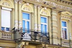 Facade and balcony. Part of the facade and balcony in Europe Stock Photos