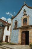 Facade covered by ceramic tiles in a baroque Church. Facade in baroque style covered by colorful ceramic tiles, at the Church of the Misericordia of Gouveia. A stock photography