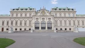 Facade of baroque style palace Belvedere in Vienna, Austria in sunny day. Moving shot stock video