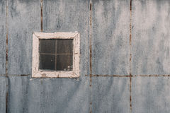 Facade of bathhouse. Small shabby single window with corrugated glass on facade of handmade bathhouse textured wall of painted ruberoid with multiple small Royalty Free Stock Photos