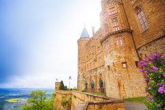 Facade of beautiful Hohenzollern castle at summer. Facade of beautiful Hohenzollern castle during summer day time and valleys from top view in Germany Royalty Free Stock Image