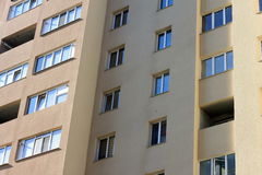 Facade of a beautiful multi-storey modern building with windows and balconies close-up Stock Photography