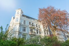 Facade of beautiful white old apartment building in the afternoon sun. In summer royalty free stock images