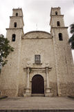 Facade and bell towers of an ancient church in historical Merida Mexico Royalty Free Stock Image