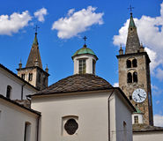 Facade and bell towers of Aosta cathedral Royalty Free Stock Photos