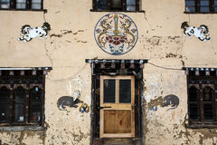 Facade of a Bhutanese house in Western Bhutan Stock Images