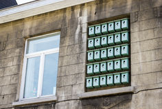 Facade of bilding with birdhouses in window  in Ghent, Belgium Royalty Free Stock Photo