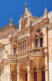 The facade of Bishop's Palace on the Pjazza San Pawl in Mdina. Mdina, MALTA – JULY 29: The Baroque style facade of the austere Bishop's Palace on the Royalty Free Stock Image