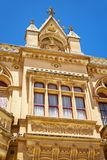 The facade of Bishop`s Palace on the Pjazza San Pawl in Mdina. M. Decorative balcony and wimperg above the portal to the Bishop`s Palace in Mdina. Malta Stock Photography