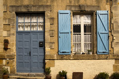 Facade with blue door and shutter Royalty Free Stock Image