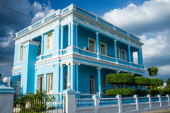 Facade of a blue mansion at the Malecon Boulevard in Cienfuegos, Cuba. Facade of a blue mansion/ house at the Malecon Boulevard in Cienfuegos, Cuba Royalty Free Stock Image