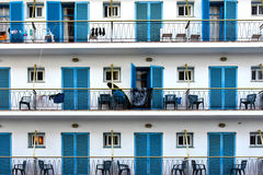 Facade with blue shutters. Detail of the facade of a hotel in Malgrat de Mar  Spain Royalty Free Stock Photography