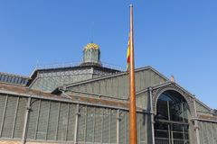 The Born Market facade, nineteenth century. Gothic Quarter of Ba. The facade of Born market, and flag of Catalonia. It is an example of iron architecture, a Royalty Free Stock Image