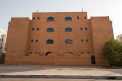 Facade of a Brown villa made of brown bricks like tiles royalty free stock photos