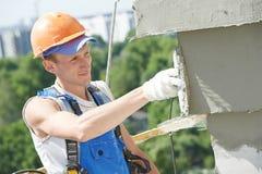 Facade builder plasterer at work Stock Photo