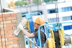 Facade builder plasterer at work Stock Image