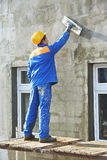 Facade builder plasterer at work Royalty Free Stock Images