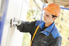 Facade builder plasterer at work Royalty Free Stock Photos