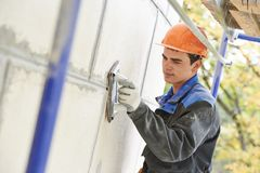 Facade builder plasterer at work Stock Photography