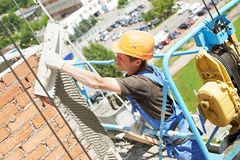 Facade builder plasterer at work Stock Photography