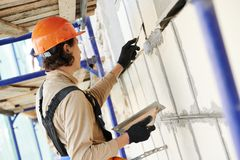 Facade builder plasterer at work Stock Photos