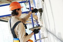 Facade builder plasterer at work Stock Image