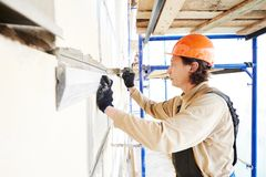 Facade builder plasterer at work Royalty Free Stock Image