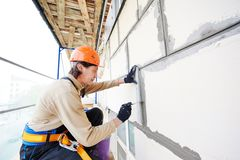 Facade builder plasterer at work Stock Photo