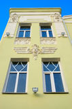 Facade of the building. With decorations from gypsum in the manner of feminine head Stock Images