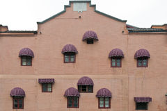 The facade of a building. With arched sunshades Stock Image