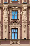The facade of the building with antique sculptures. Royalty Free Stock Photography