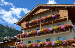 Facade of the building with balconies, decorated with flowers Royalty Free Stock Images