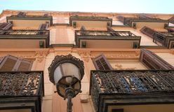 Facade of a building with balconies with wrought iron railings very elaborate to Malaga in Spain Royalty Free Stock Photo