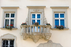 Facade of a building with a balcony and flowers Stock Photography