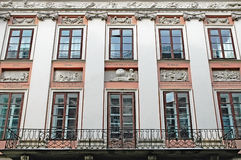 Facade of the building with bas-reliefs Stock Image