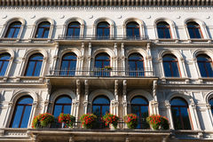 Facade building and flowers in forefront. Pan view of beautiful building facade in the city of Leipzig in germany Royalty Free Stock Photos