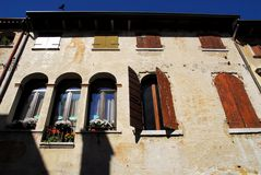 Facade of a building with flowers in Oderzo in the province of Treviso in the Veneto (Italy) Stock Image