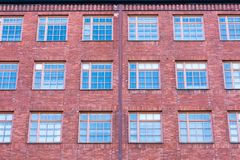 Facade of the building with large lattice windows.  stock photos