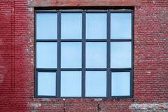 Facade of the building with a large square window. Horizontal frame Stock Image