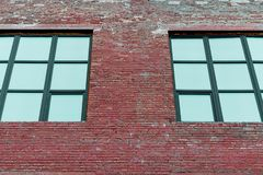 Facade of the building with large square windows. Horizontal frame stock photos
