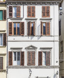 The facade of a building in one of the streets in Florence. Travel Stock Images