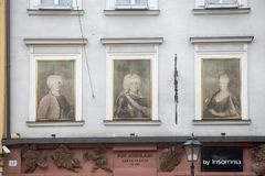 The facade of the building with portraits on the wall at the street Grodzka 35 in the old town on the market square royalty free stock photos
